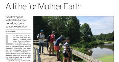 "Thumbnail of news article entitled, ""A tithe for mother earth: New New Paltz Plans Real-Estate Transfer Tax to Fund Open-Space Preservation"" with a photo of five people standing on a viewing platform over a wetland. The first two paragraphs of the article are included in the screen shot."